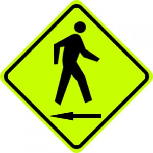 Sign with person walking backwards