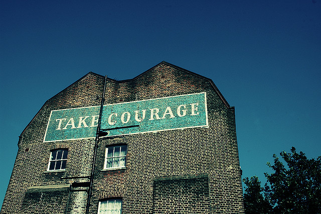 "Sign that reads ""take courage"""